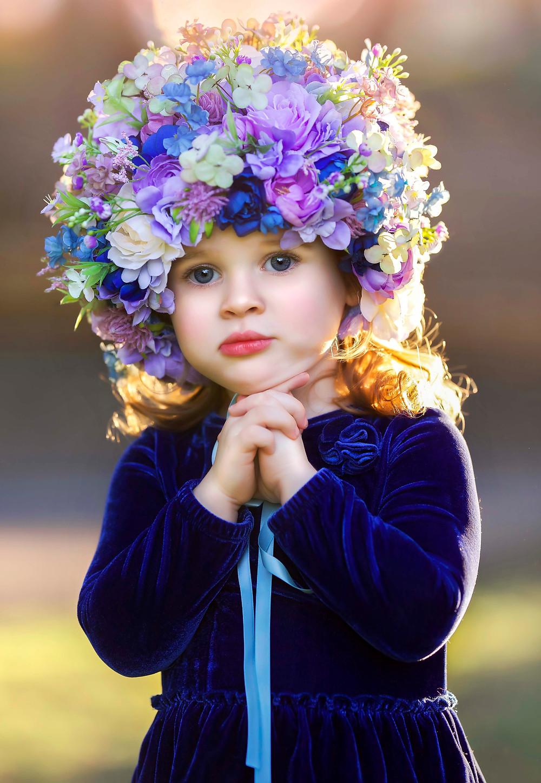 blue eyed girl wearing a flower crown