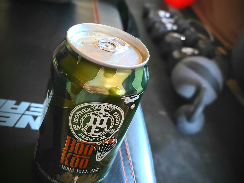 Beer Can sitting next to a home gym