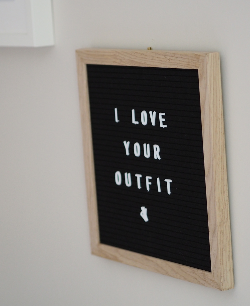 Wooden peg board saying 'I love your outfit' in the Wild Home Online office