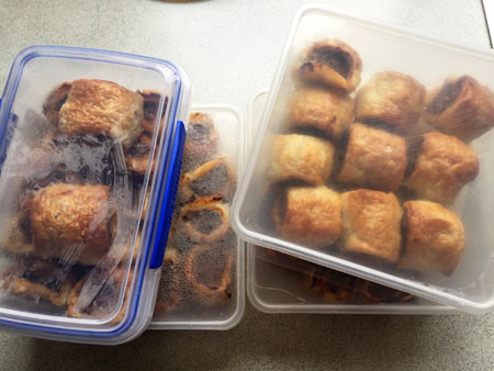 Left: Two rolls ready for egg wash and cutting Right: 4 batches of 12 sausage rolls each.