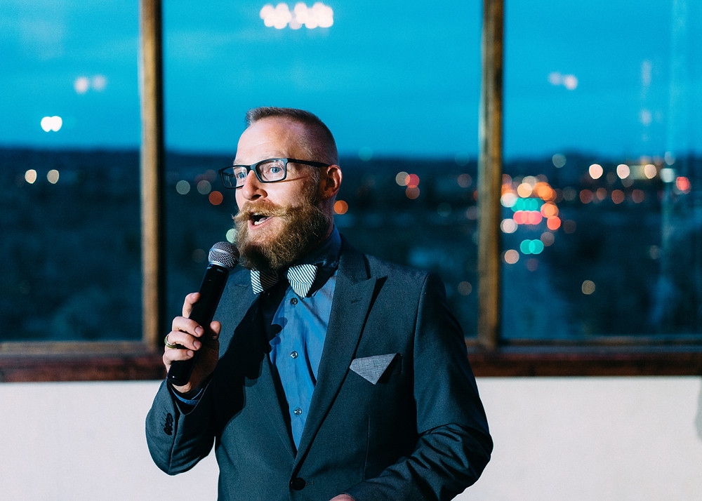 Emcee giving a speech in front of city lights