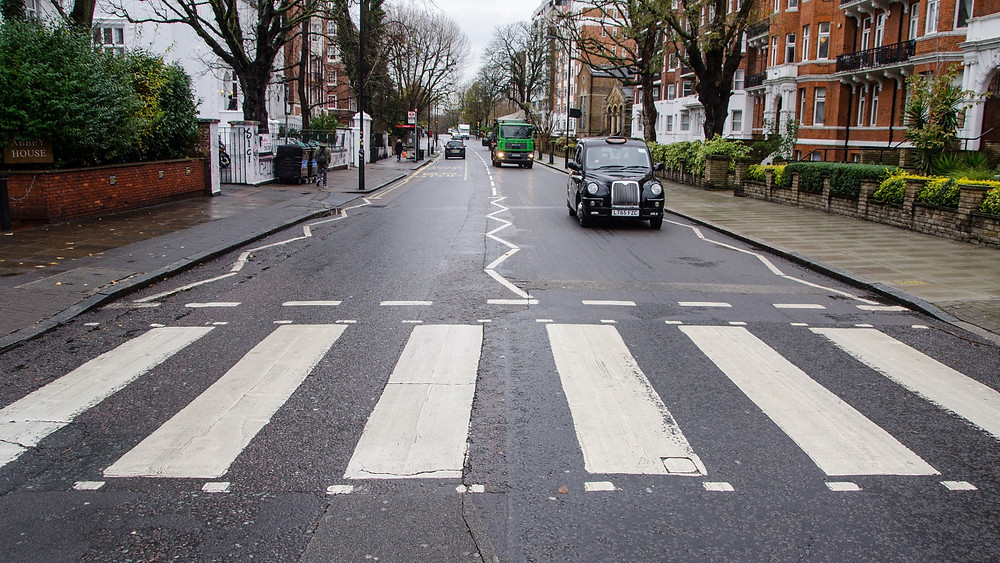 Abbey Road zebra crossing in St John's Wood, London. Scene of the famous Beatles album cover for Abbey Road