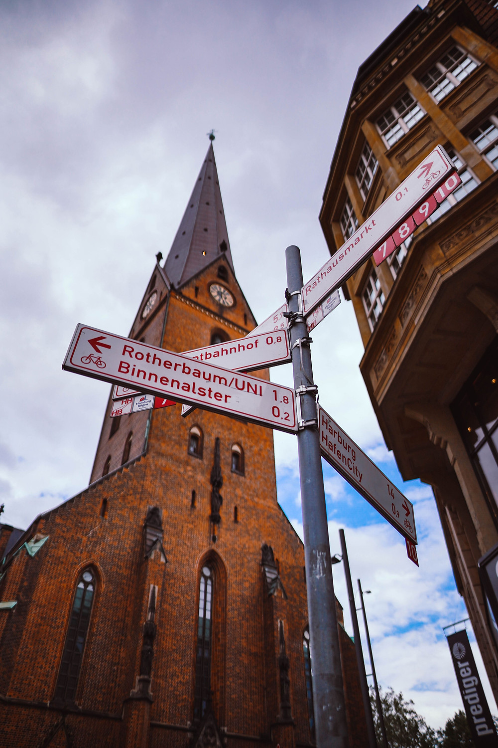 cathedral with road signs in front; Vanessa Schmid on Unsplash