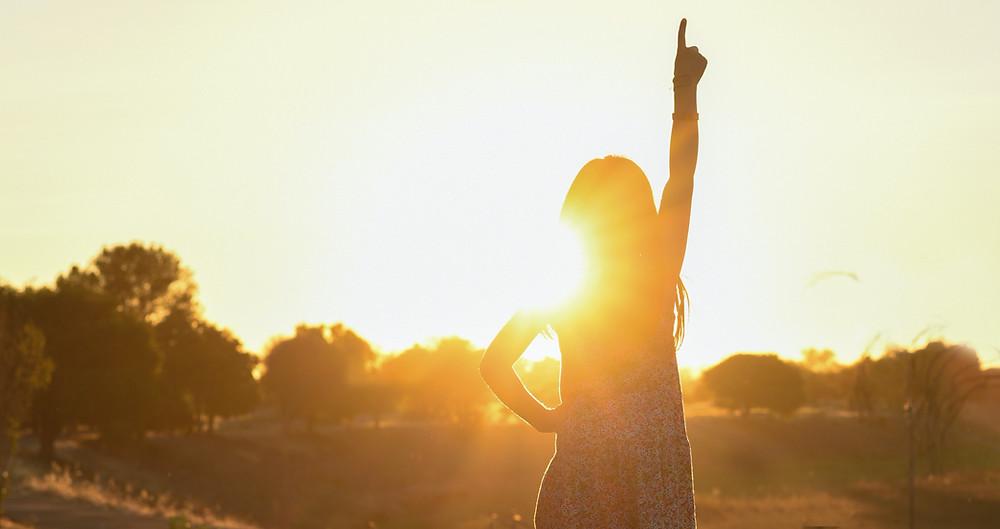 Girl standing in Sun light
