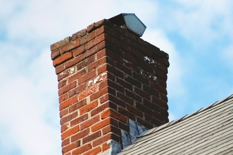 Old brick chimney needing repair