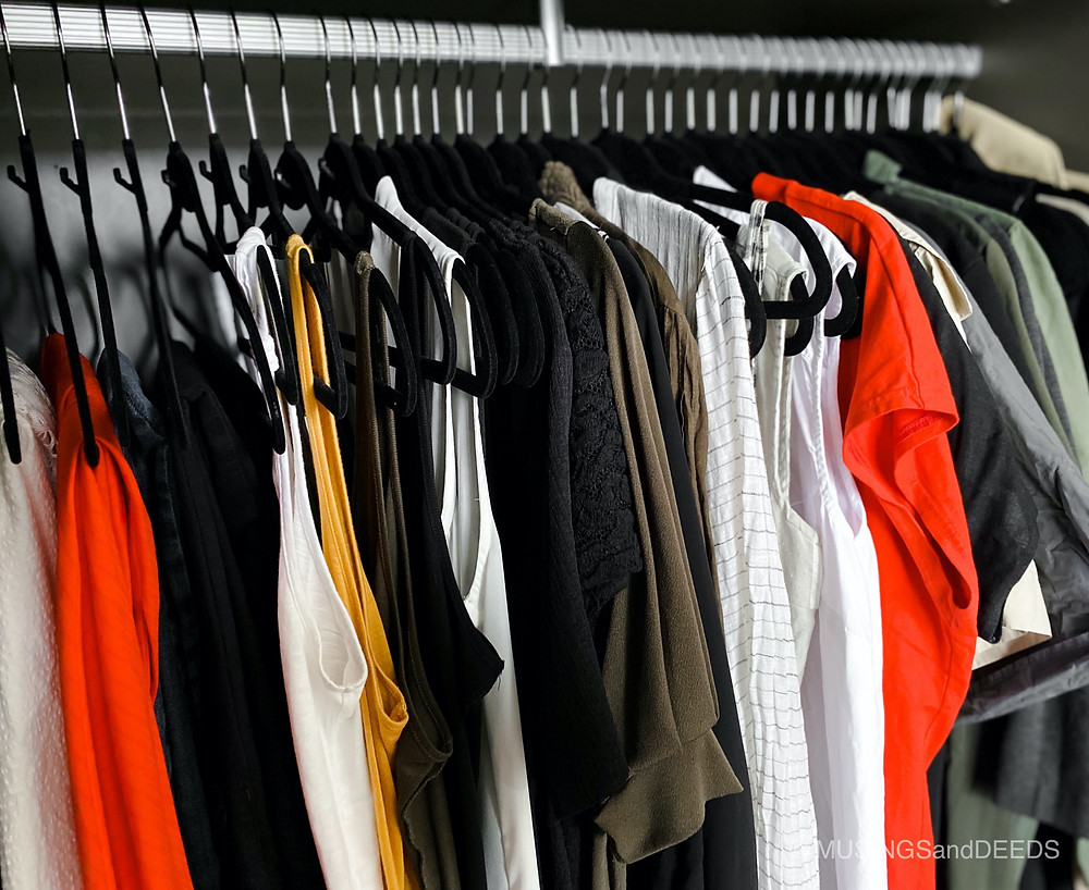 Clothes organised in closet