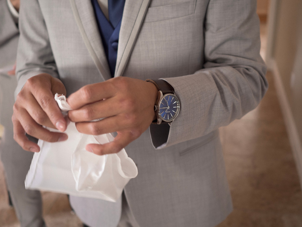 Groomsmen watch, jacket, and pocket square detail