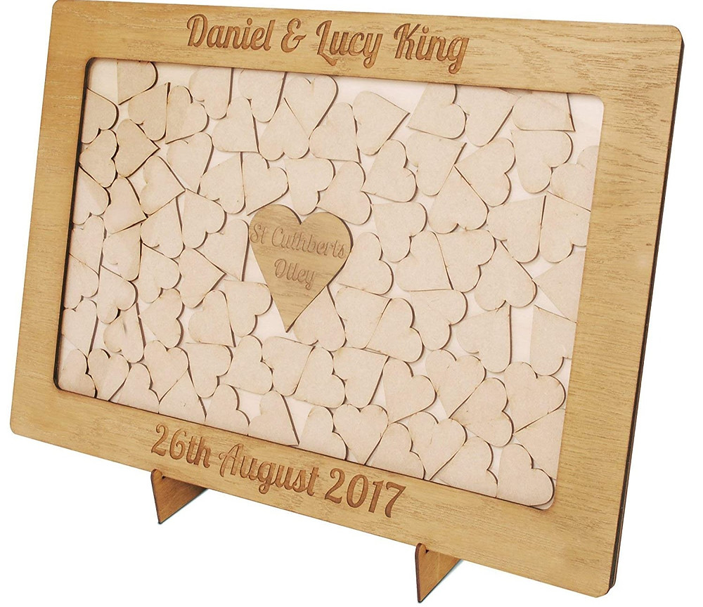 A personalised framed shadow box filled with wooden hearts, signed by guests