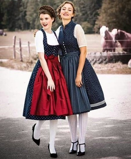 Brunette European women in traditional attire.