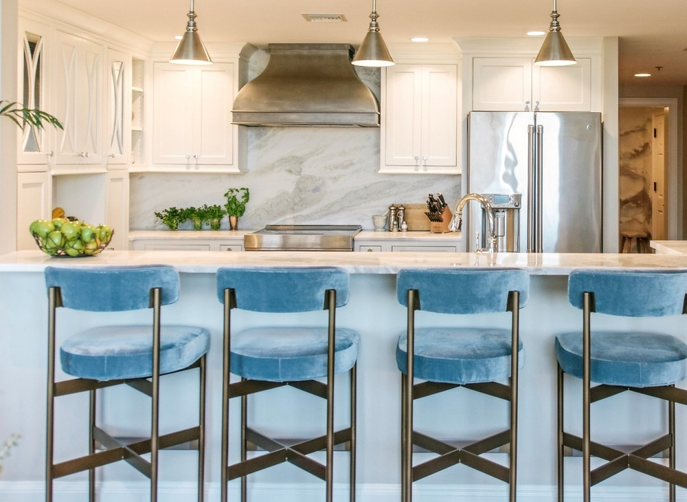 custom white cabinets. sub-zero wolf appliances. hood range. velvet chairs. Atlanta kitchen. renovation remodeling kitchen design