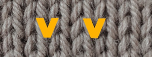 """The right side of stockinette, showing the """"v"""" shape for the front of a knit stitch."""