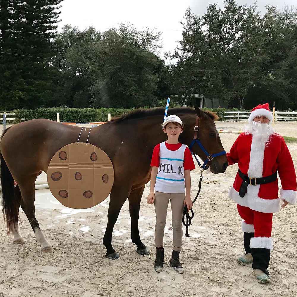 "Our rider Petunia took Cookie to Condee's Christmas Horseshow as well as the December Heritage Horse Show.  Petunia dressed Cookie as ""Milk and Cookies"" at the Condee Show. How cute! As usual, a great time was had by all.  At Heritage Horse Show Petunia had her first true horseshow experience!  She did an amazing job riding to a Reserve Championship in the Open Walk/Trot.  Those competing came from Miami, Southwest Ranches, and beyond. Petunia had a great time showing off what she has learned in her lessons at both events."