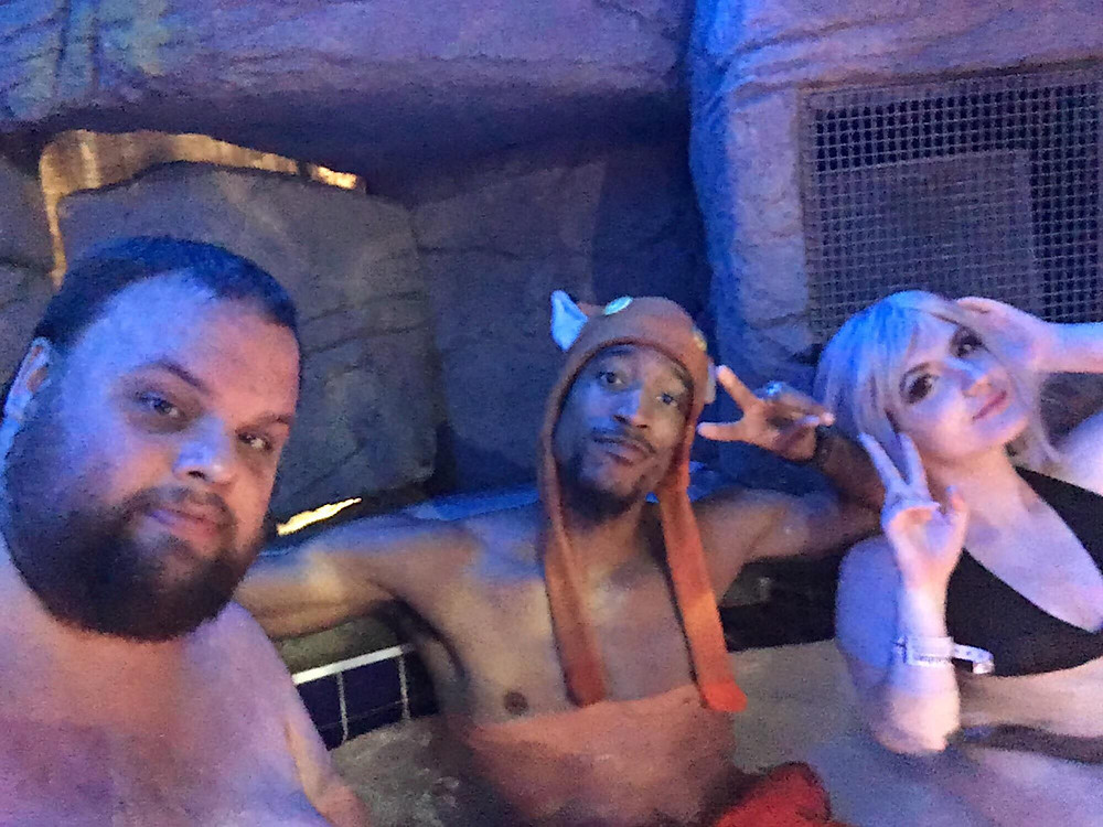 Darkfox Photography and two friends enjoying the hot tub at Colossalcon East 2018