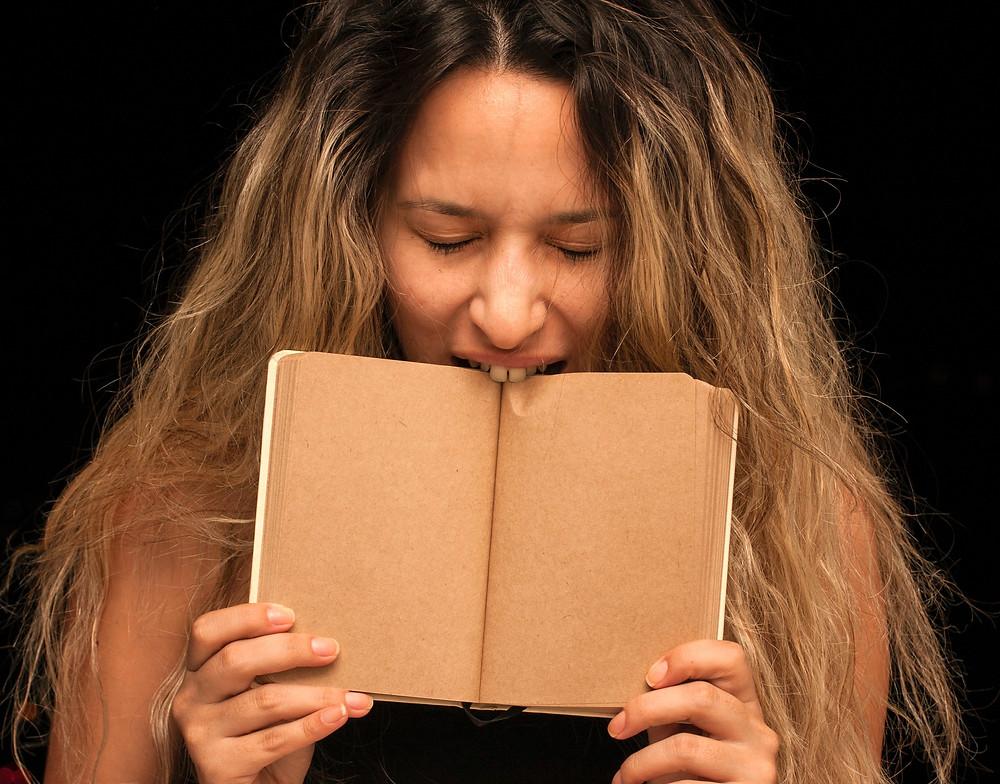 angry-woman-biting-book.jpg