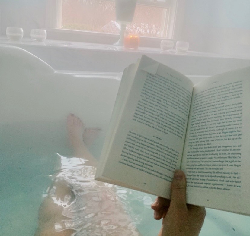 reading a book in the hot tub