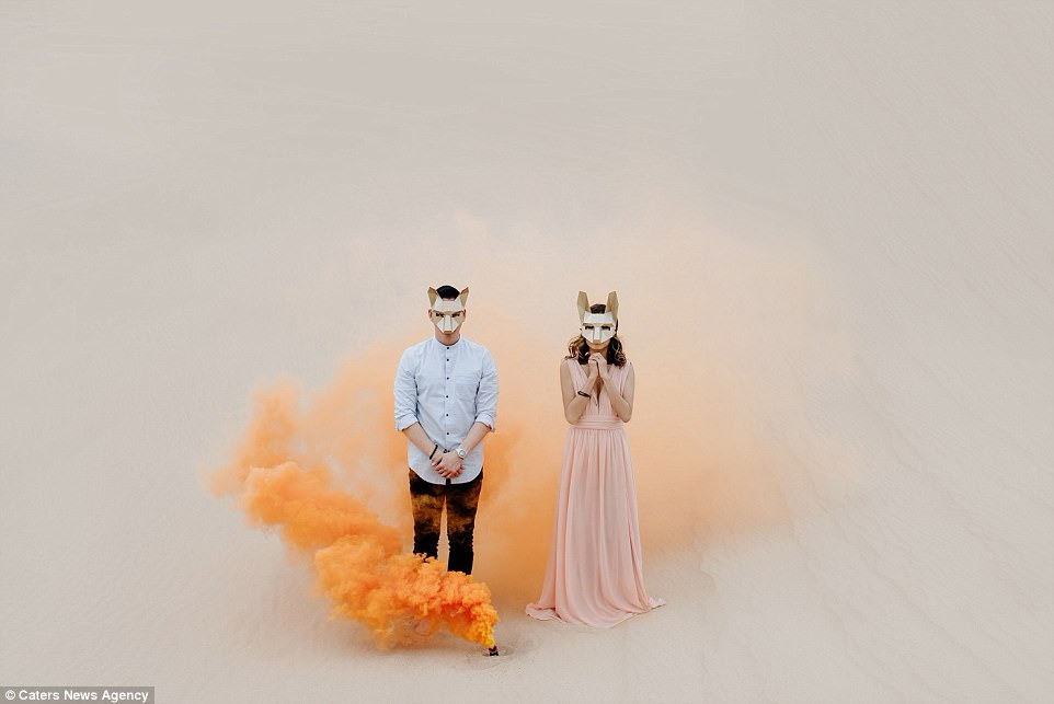Wedding Photoshoot Props: Couples in fox masks in the middle of nowhere with burst of orange colored powder