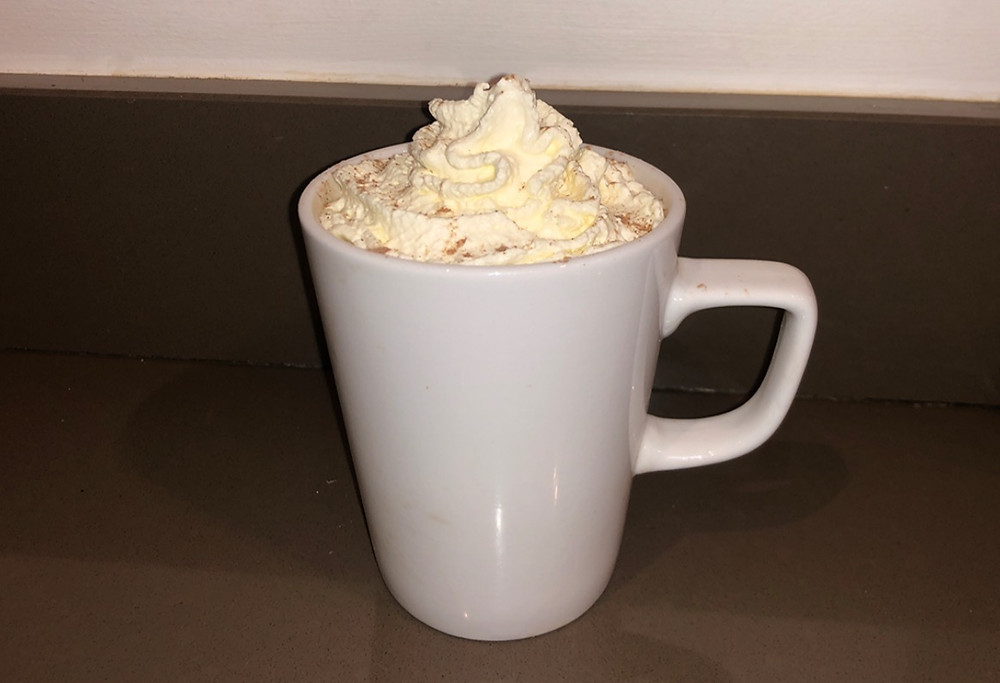 Hot chocolate with whipped cream made from the ProWhip Whipping Dispenser
