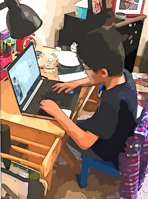 Author Kid Learning thorugh Laptop
