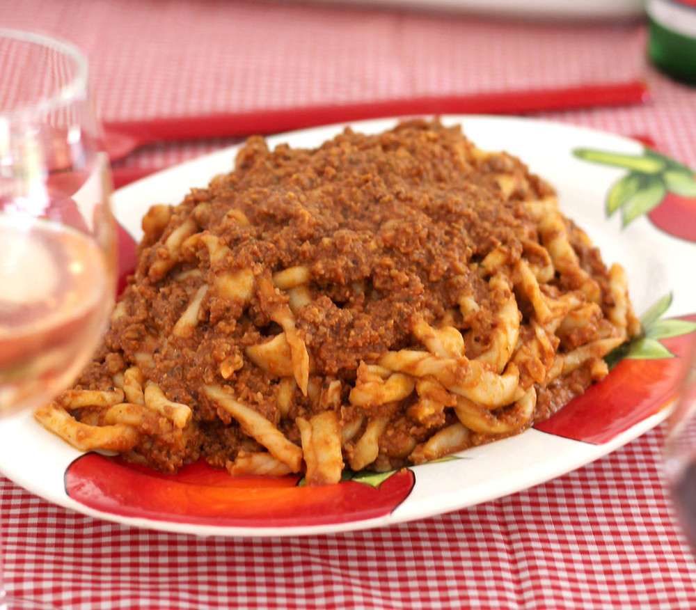 Sagne torte with walnut ragu