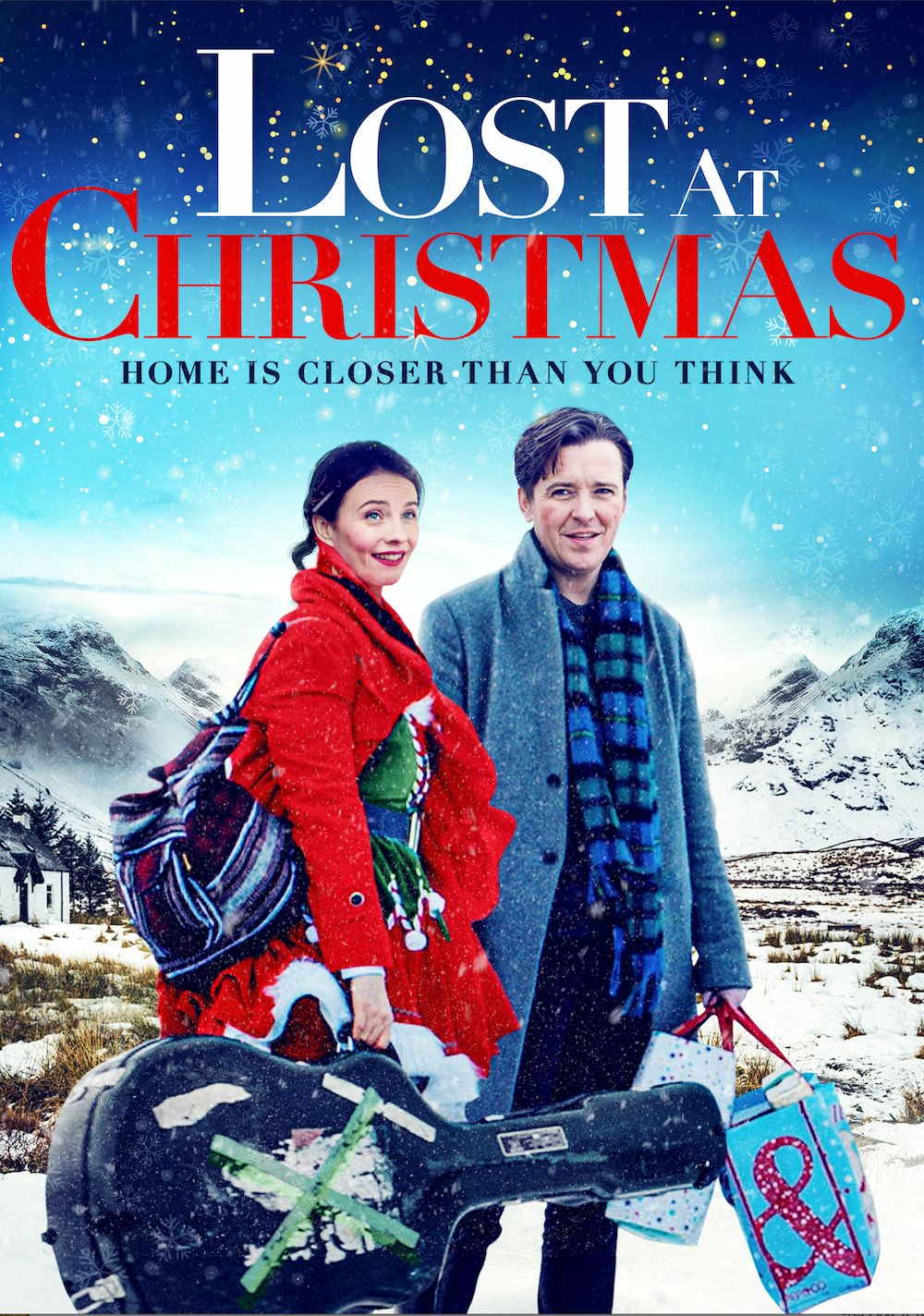 Lost at Christmas movie poster featuring a white man and a white woman. The woman wears a read jacket and carries a guitar case. The main has a blue coat and carries shopping bags.