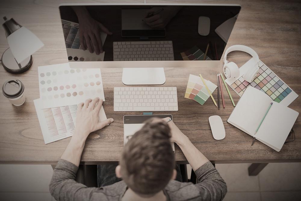 Man designer working using color swatches. Side Hustle