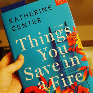 Things You Save in a Fire by Katherine Center, held in Nicole's hand