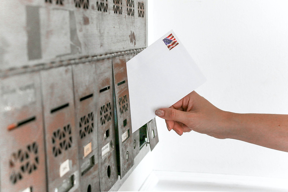 voter puts their ballot in the mail