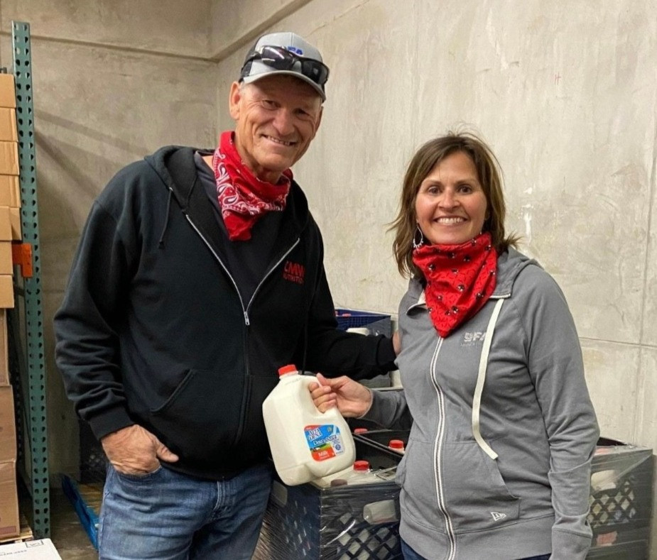 Dairy farmers, Ken and Sherrie DeVries of Hinkley Dairy deliver donated milk to local food bank.