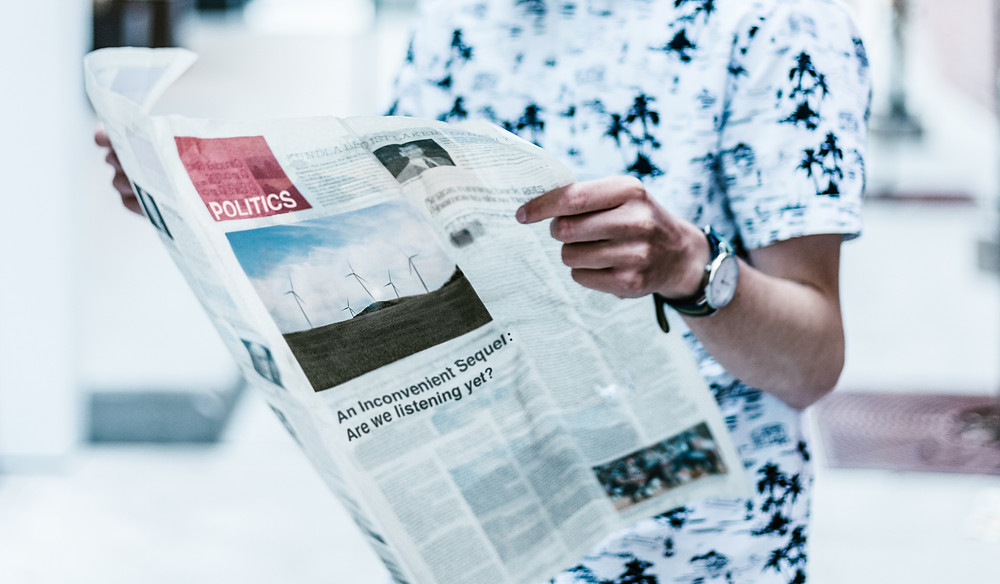 Photo of young person reading the politics section of a paper: Priscilla Du Preez on Unsplash