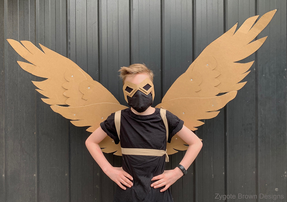 Mechanical wings that articulate open and closed made out of cardboard.