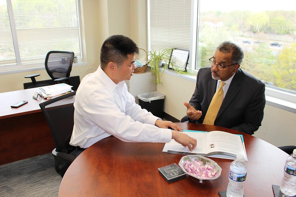 Dr, Zhensen Huang Meets with Antonio Doss, SBA District Director