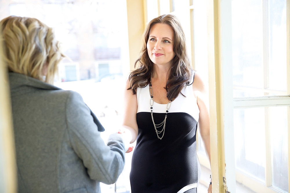 business woman shaking hands at an interview