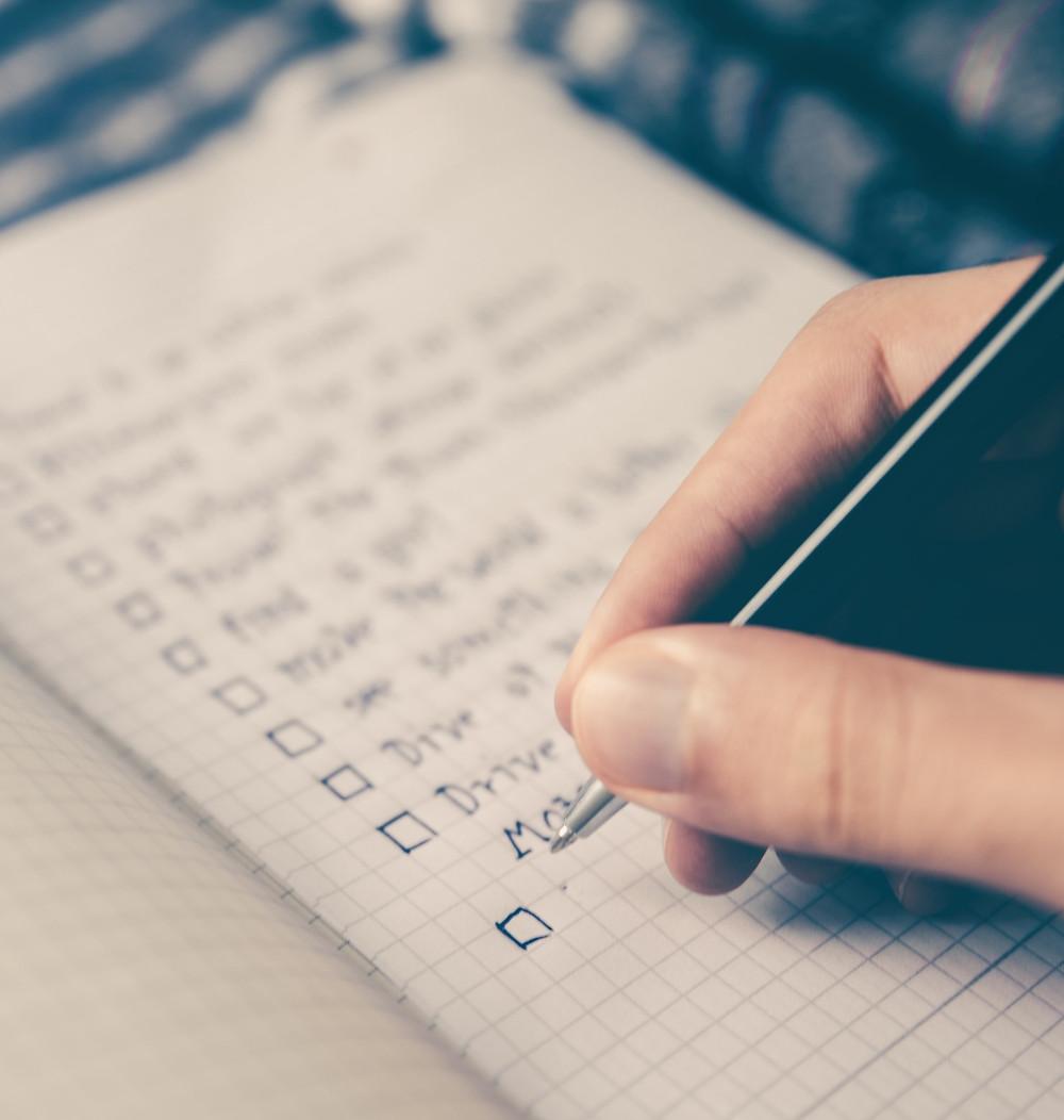 Ecriture d'une checklist dans un cahier