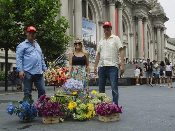 José R. Azout, Catalina Arango Gómez and Daniel Vélez in front of the Metropolitan Museum of Art in New York