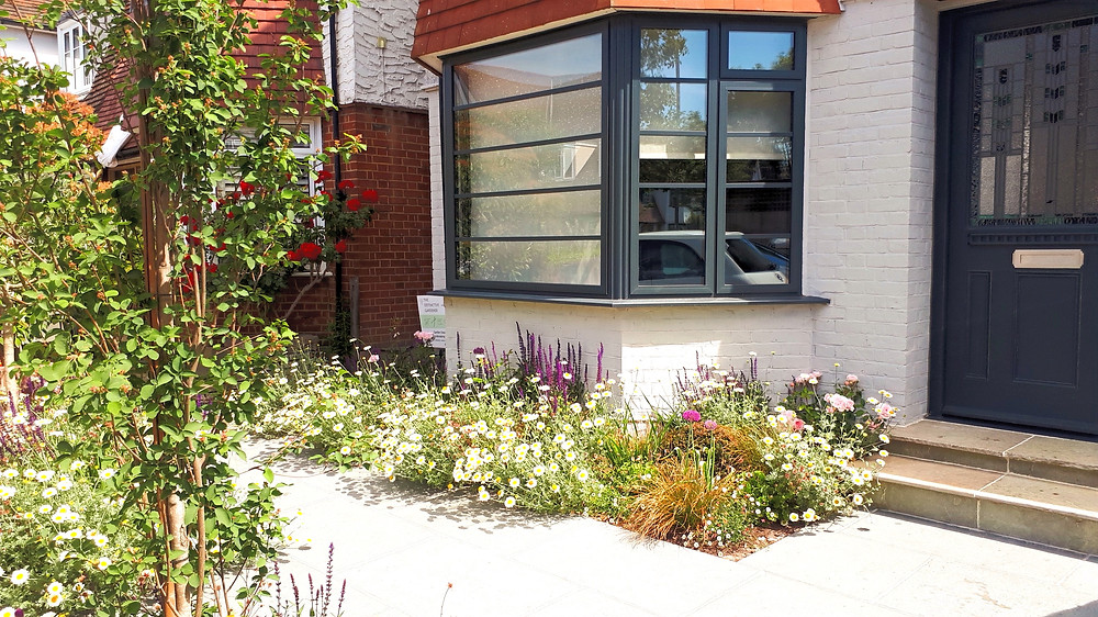 Flower–Filled Front Garden with Off Street Parking