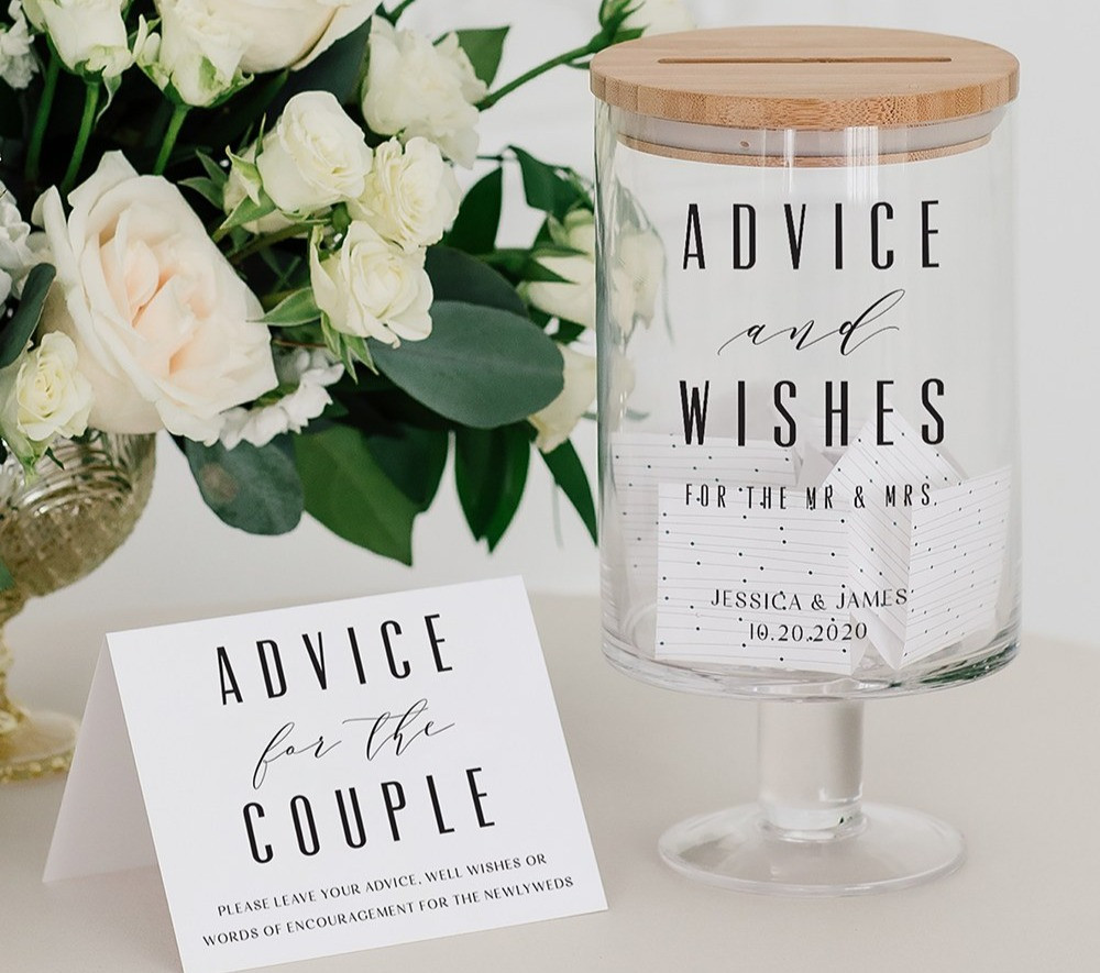 A glass wedding wishes jar