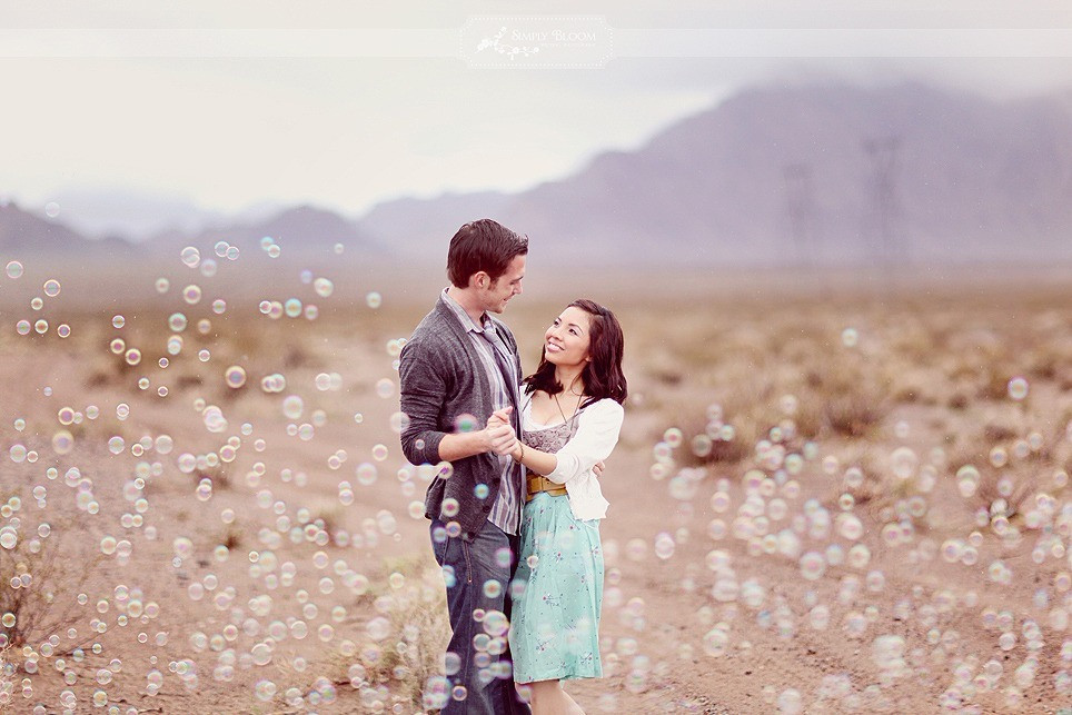Wedding Photoshoot Props: Couple dancing in a field with bubbles surrounding them