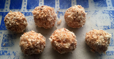 Dip balls of tuna and potato mixture in beaten egg and roll in bread crumbs.