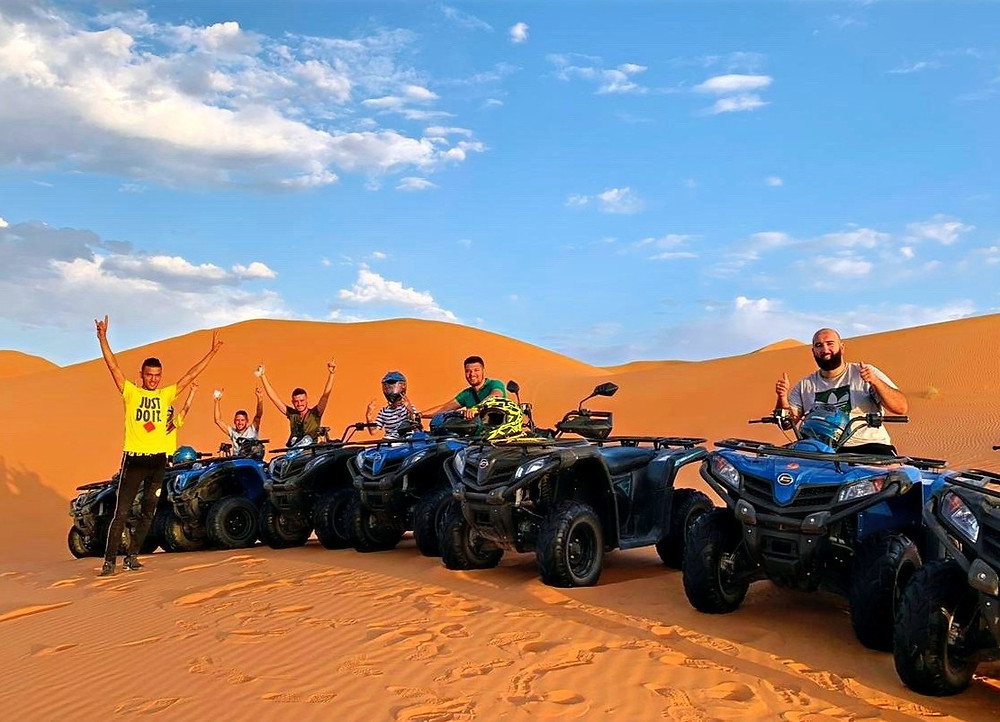 quad riding in Sahara desert in Morocco