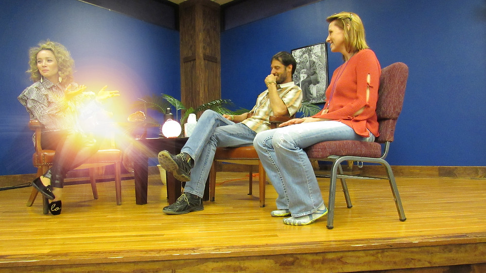 Leslie Juvin-Acker with couple on stage at Edgar Cayce's A.R.E. in Virgina Beach, VA