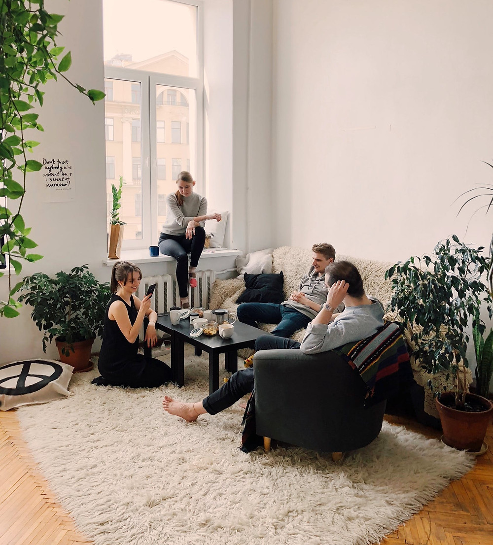 large living room with group having conversation
