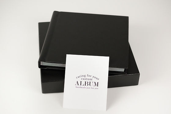 black custom photo album with care card info