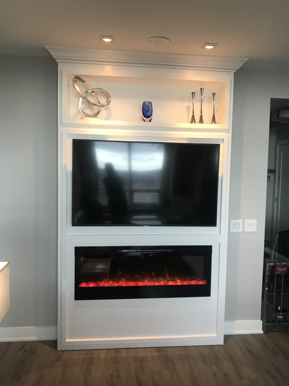 Custom built fireplace and tv mantel with recessed shelf.