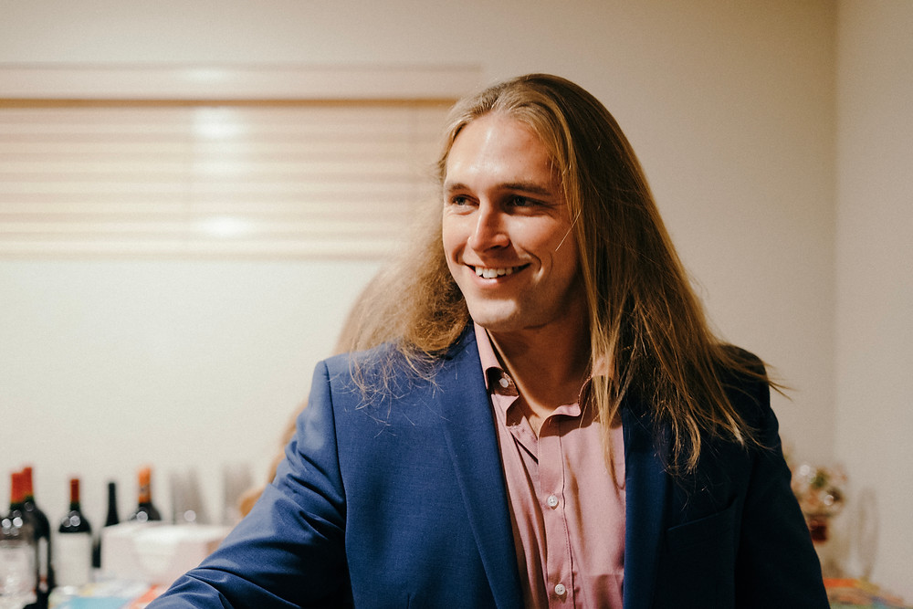 Man smiling at guests