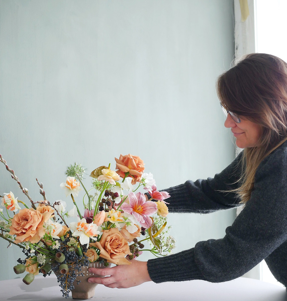 San Diego Wedding florist creating a vibrant and textured centerpieces