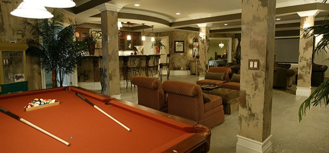 Luxury finished basement with a pool table in a Lucke custom home in Mason, Ohio