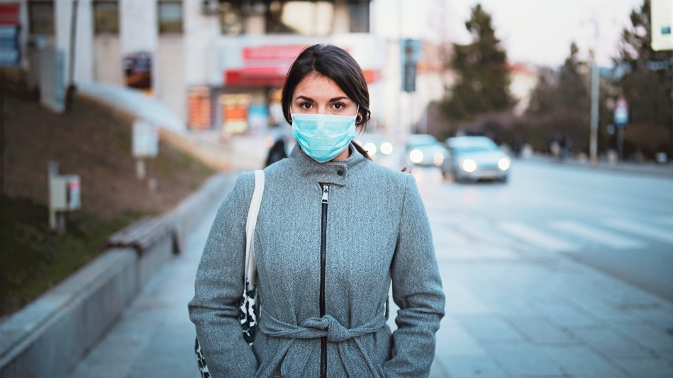 Woman returning to work with a mask