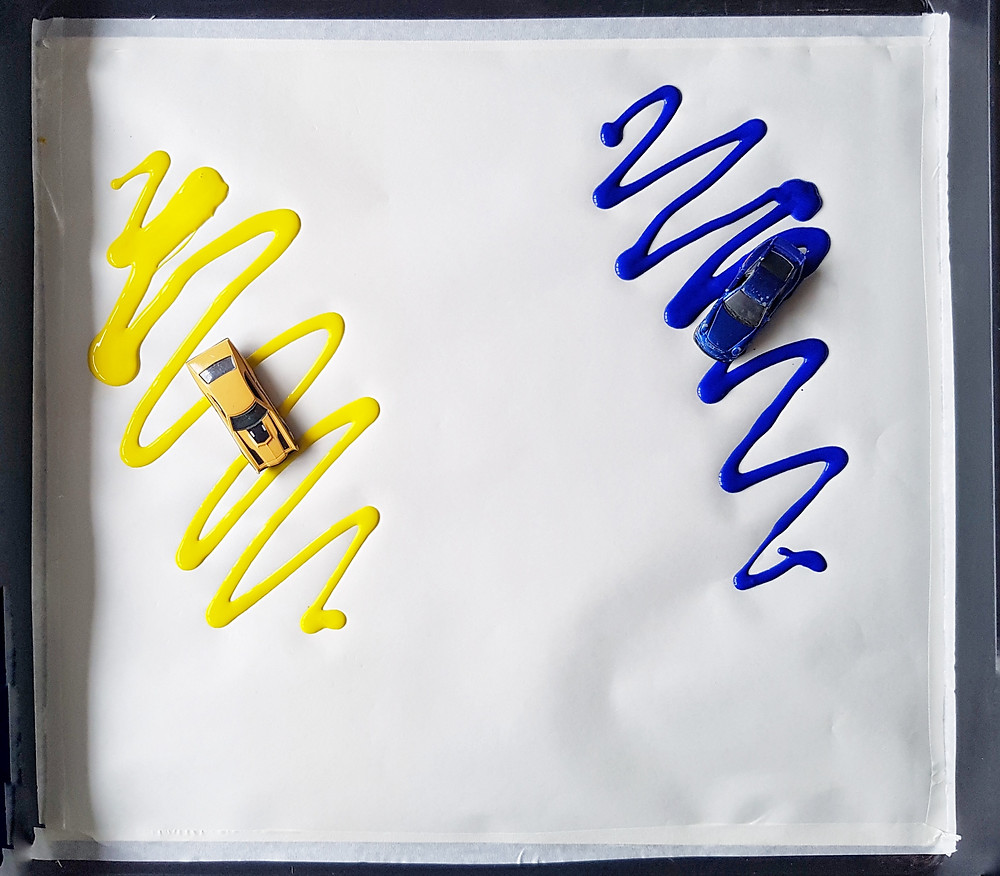 Colour mixing blue and yellow with toy cars