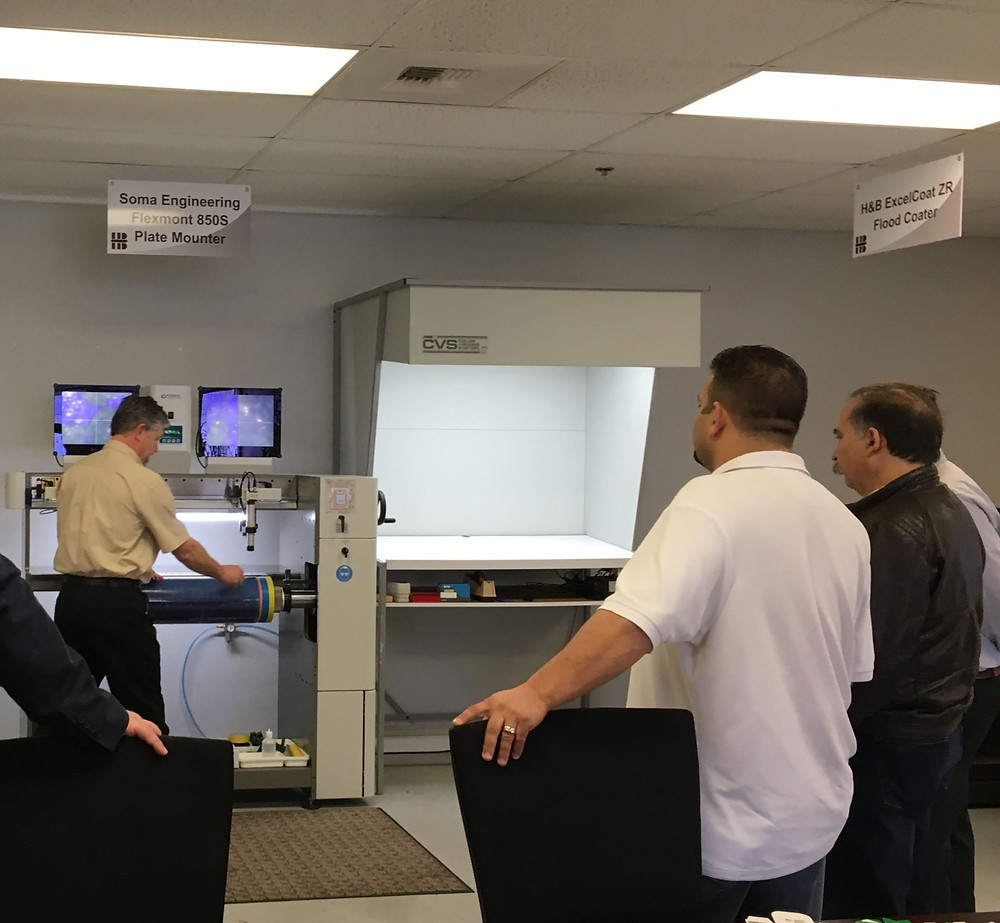 Innovation Center Manager Graeme Pawson utilizes the Soma Engineering Flexmont 850S Plate Mounter to prepare a SpeedMount Sleeve for spot coating on the ExcelCoat ZRS.