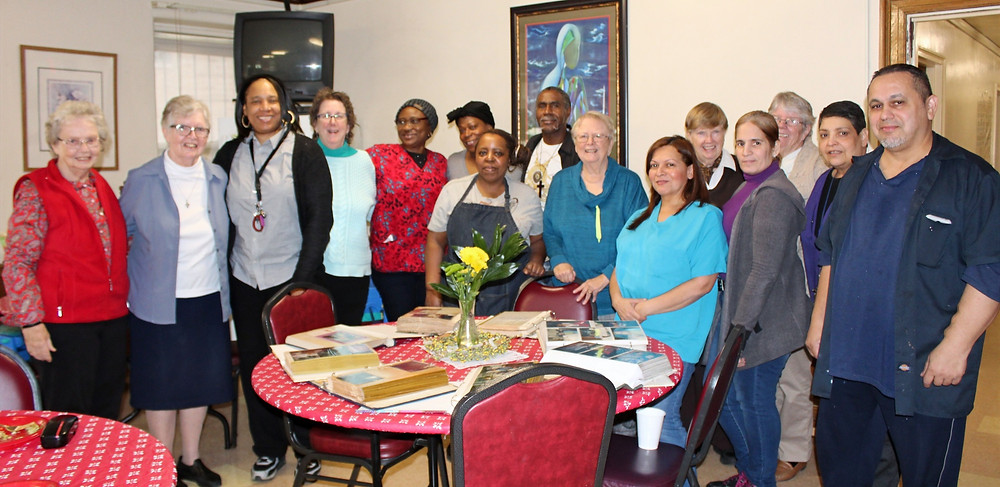 Siena House staff and friends gather together to celebrate their 30th Anniversary